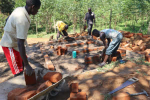 The Water Project: Kinu Friends Secondary School -  Community Members Aid In Latrine Construction