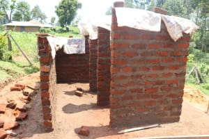 The Water Project: Friends Kisasi Secondary School -  Latrine Walls Construction