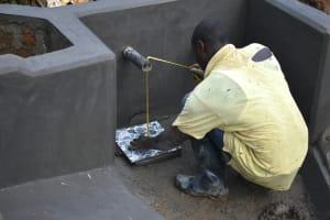The Water Project: Shitavita Community, Patrick Burudi Spring -  Tile Fixing