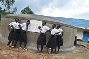 The Water Project: Kinu Friends Secondary School -  Girls Celebrate The Tank