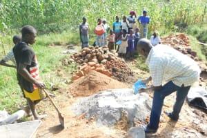 The Water Project: Maraba Community, Nambwaya Spring -  Preparing Construction Materials