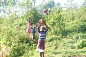 The Water Project: Maraba Community, Nambwaya Spring -  Carrying Bricks To The Spring