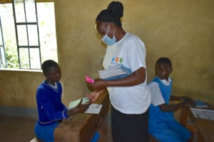 The Water Project: Ivakale Primary School & Community - Rain Tank 1 -  Trainer Mary Issues Training Materials To Pupils