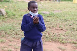 The Water Project: Kapkoi Primary School -  A Student Demonstrates Handwashing