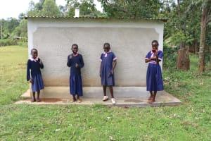 The Water Project: Kapkoi Primary School -  Girls Celebrate Next To Their Latrines