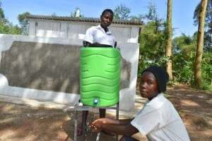 The Water Project: Kinu Friends Secondary School -  Girls Handwashing Outside Of Their Latrines