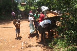 The Water Project: Makale Community, Luyingo Spring -  Unloading A Brick Delivery