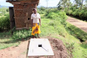 The Water Project: Silungai B Community, Tali Saya Spring -  Ruth With Her New Sanplat