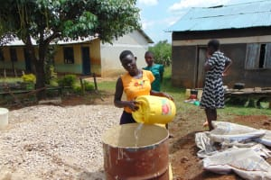 The Water Project: Ivakale Primary School & Community - Rain Tank 1 -  Students Deliver Water For Construction