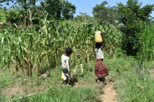 The Water Project: Maraba Community, Nambwaya Spring -  Heading Home With Clean Spring Water