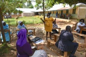 The Water Project: Ivakale Primary School & Community - Rain Tank 1 -  Director Catherine Chepkemoi Addresses Parents