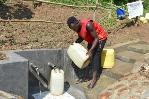 The Water Project: Maraba Community, Nambwaya Spring -  Rinsing And Fetching At The Same Time