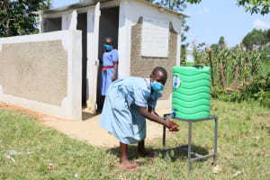 The Water Project: Mukoko Baptist Primary School -  Girls At Their New Latrines And Handwashing Station