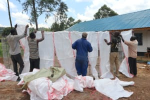 The Water Project: Kinu Friends Secondary School -  Wrapping Sugarsacks To Tank Frame