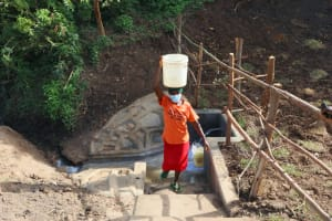 The Water Project: Silungai B Community, Tali Saya Spring -  Leaving The Spring With Clean Water