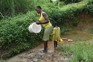The Water Project: Mundoli Community, Pamela Atieno Spring -  Washing Her Water Container