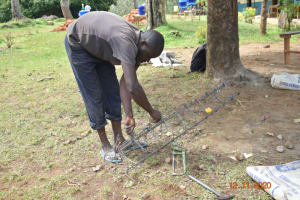 The Water Project: Isango Primary School -  Preparing Wire For Use