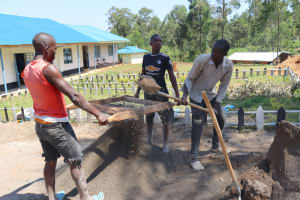 The Water Project: Kinu Friends Secondary School -  Sieving Sand For Plastering