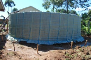 The Water Project: Friends Kisasi Secondary School -  Sugar Sacks On Tank Skeleton Wall
