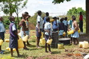 The Water Project: Isango Primary School -  Students Provide Water For Construction