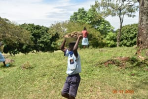 The Water Project: Isango Primary School -  Students Work Together To Bring In Construction Materials