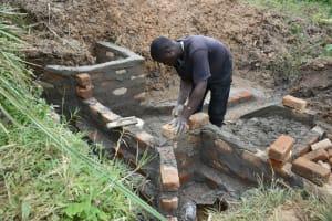 The Water Project: Shitavita Community, Patrick Burudi Spring -  Bricklaying
