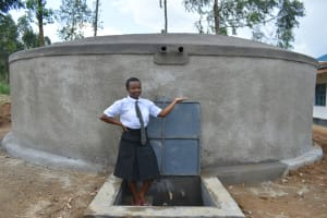 The Water Project: Kinu Friends Secondary School -  Edith Holds A Glass Of Water From The Tank