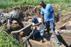 The Water Project: Shitavita Community, Patrick Burudi Spring -  Fixing Discharge Pipes