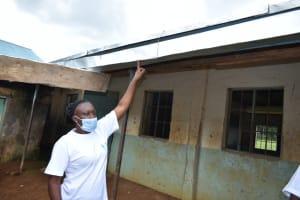 The Water Project: Ivakale Primary School & Community - Rain Tank 1 -  Trainer Mary Afandi Explaining Gutter Maintenance