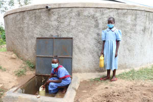 The Water Project: Mukoko Baptist Primary School -  Collecting Water At The Tank