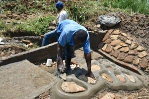 The Water Project: Shitavita Community, Patrick Burudi Spring -  Stone Pitching