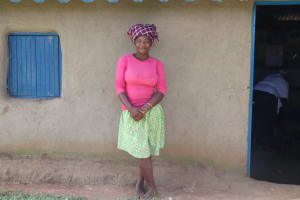 The Water Project: Luyeshe Community, Matolo Spring -  Rose Nasenya Outside Her House
