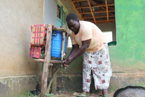The Water Project: Luvambo Community, Timona Spring -  Washing Her Hands