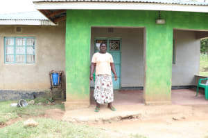 The Water Project: Luvambo Community, Timona Spring -  Gladys Outside Her House