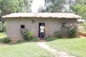 The Water Project: Futsi Fuvili Community, Simeon Shimaka Spring -  John Shimaka At Home
