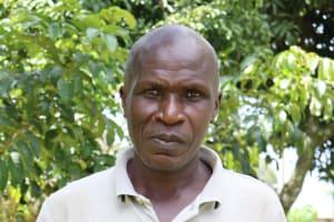 The Water Project: Futsi Fuvili Community, Simeon Shimaka Spring -  John Shimaka