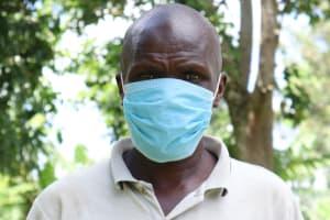 The Water Project: Futsi Fuvili Community, Simeon Shimaka Spring -  Masked Up