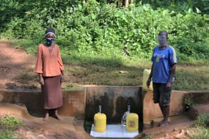 The Water Project: Rosterman Community, Kidiga Spring -  David And His Wife At The Spring