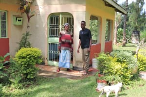 The Water Project: Rosterman Community, Lishenga Spring -  Emmanuel And His Mom Outside Their Home