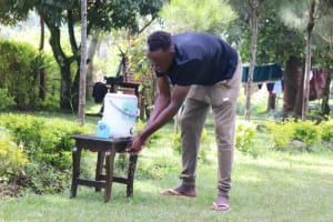The Water Project: Rosterman Community, Lishenga Spring -  Emmanuel Washing His Hands