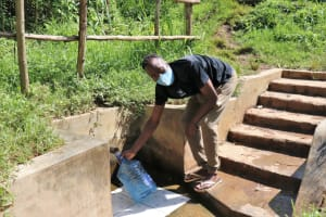 The Water Project: Rosterman Community, Lishenga Spring -  Fetching Water