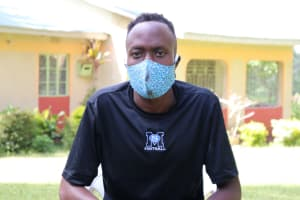 The Water Project: Rosterman Community, Lishenga Spring -  Masked Up