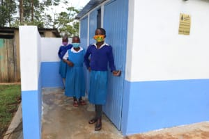 The Water Project: Ivakale Primary School & Community - Rain Tank 1 -  Girls Posing At Their Latrines