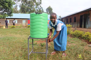 The Water Project: Ivakale Primary School & Community - Rain Tank 1 -  Metrine Washes Her Hands