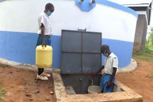 The Water Project: Ivakale Primary School & Community - Rain Tank 1 -  Pupils Collecting Water