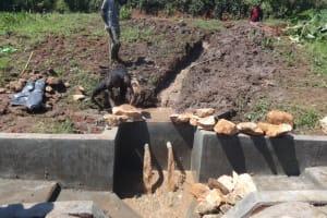 The Water Project: Mahira Community, Anunda Spring -  Backfilling Begins