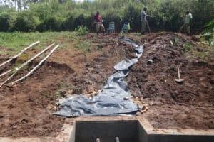 The Water Project: Mahira Community, Anunda Spring -  Fitting The Tarp