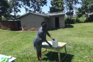 The Water Project: Mahira Community, Anunda Spring -  Making A Leaky Tin For Handwashing