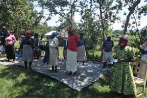 The Water Project: Mahira Community, Anunda Spring -  Community Members Pray At The Training