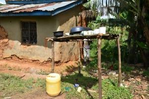 The Water Project: Mundoli Community, Pamela Atieno Spring -  Dishrack